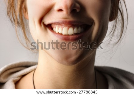 Close up of smiling mouth - stock photo