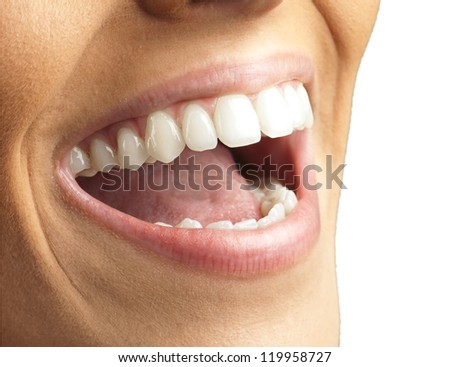 Close Up Of Smiling Teeth Isolated On White Background - stock photo