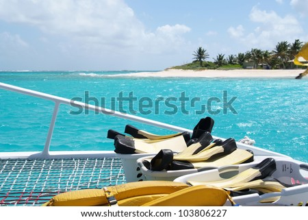 Close up of snorkling equipment aboard a catamaran - stock photo