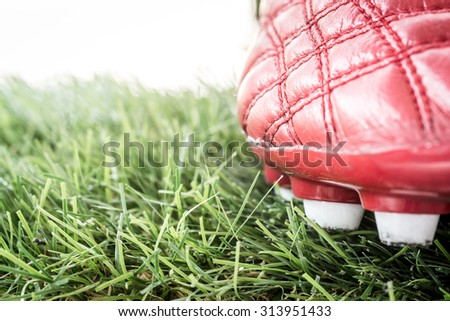 close up of soccer or football boots on grass and bokeh background - stock photo