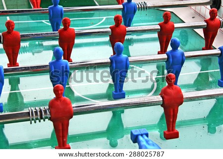 Close up of Soccer table game with blue and red players - stock photo