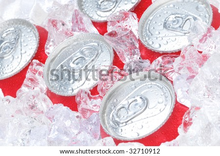 Close Up of Soda Cans in Ice with Condensation - stock photo