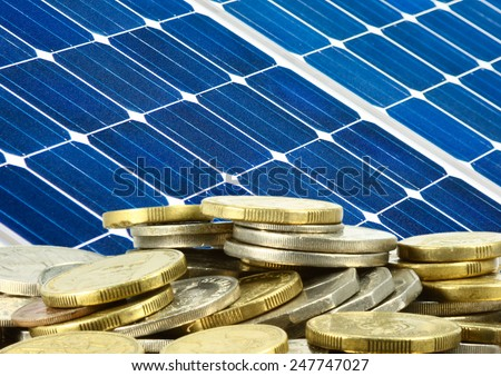 close up of solar panel and money saving - stock photo