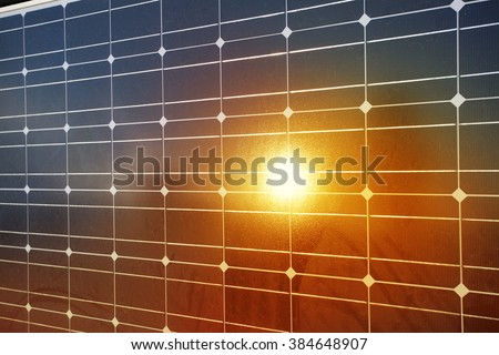 Close-up of solar panels with reflection of sunlight. - stock photo