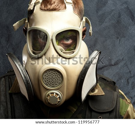 Close-up Of Soldier Wearing Mask against a grunge background - stock photo