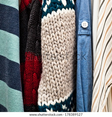 Close up of some  assorted clothes hanging - stock photo