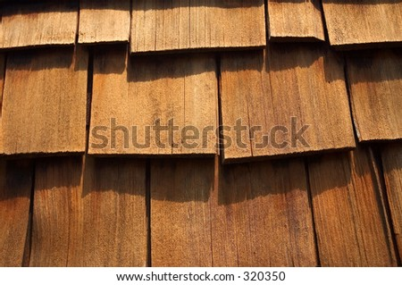 Close- up of some cedar wood shingles. Makes a nice background image. - stock photo