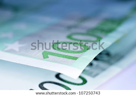 close up of some 100 euro bills - stock photo