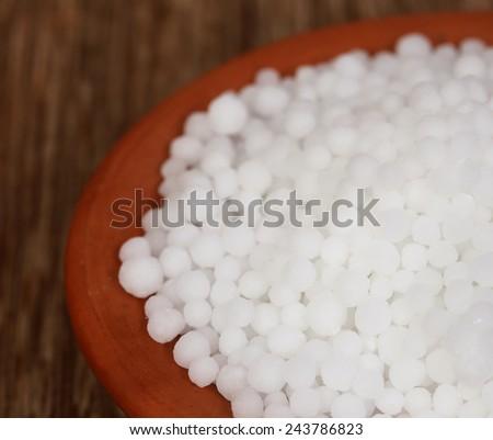 Close up of some Urea Fertilizer on a bowl - stock photo