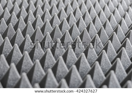 Close up of Sound Absorbing Sponge in Recording Studio. Dampening Acoustical Foam in Music Studio. Acoustic Foam Detail. - stock photo