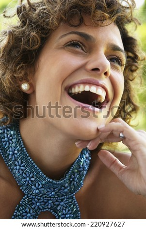 Close up of South American woman laughing - stock photo
