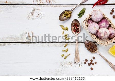 Close up of Spices. Herbs and spices selection - old metal spoons and white wooden background. Cooking, food or health concept. - stock photo