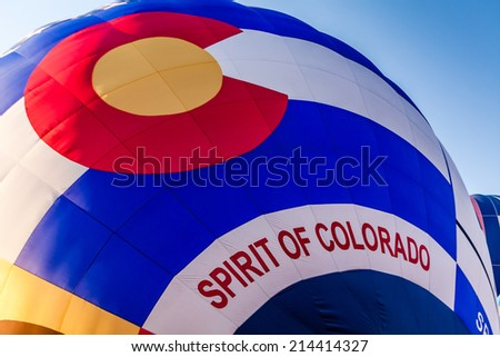 Close up of Spirt of Colorado hot air balloon being inflated before take off - stock photo