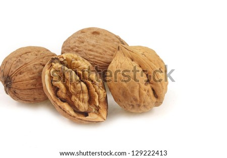 close up of split and whole walnut on white background - stock photo