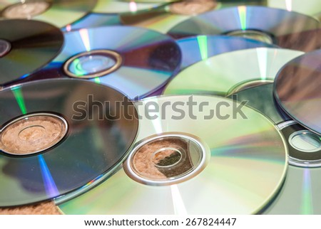 close-up of  stack of cd and of purple dvd collection - stock photo
