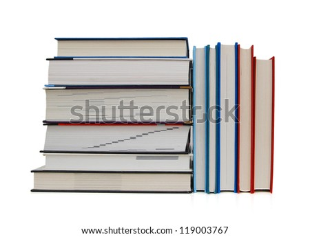 close up of stack of colorful books on white background - stock photo