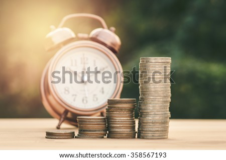 Close up of stacking gold coins with green bokeh background ,Business Finance and Money concept,Save money for prepare in the future.vintage process style - stock photo
