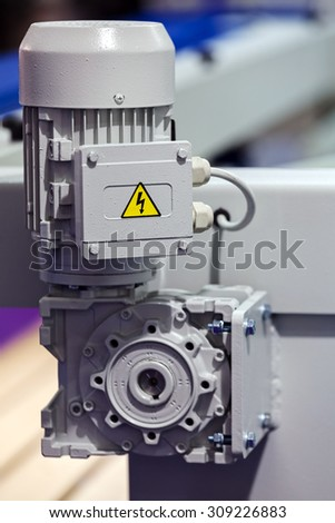 close up of stainless steel and aluminum  woodworking machine - stock photo