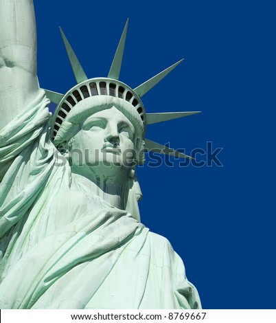 Close-Up of Statue of Liberty against a clear blue sky. - stock photo