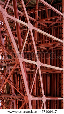 close-up of steel red bridge support - stock photo