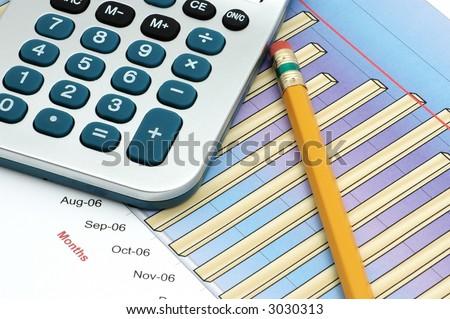 Close-up of Stock Market Volume Bar Chart, Calculator and Pencil - stock photo