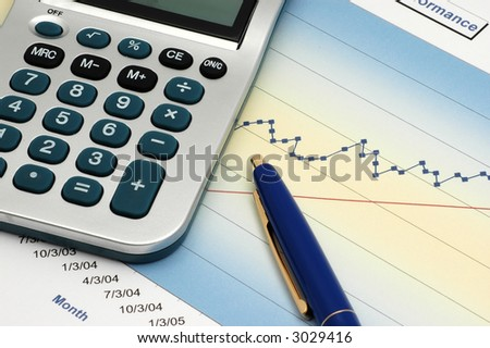 Close-up of Stock Report with Calculator and Blue Pen - stock photo