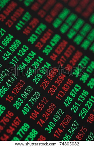 Close up of stocks & shares figures - some in the red & some in the green - shallow dof - stock photo