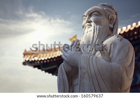 Close-up of stone statue of Confucius - stock photo