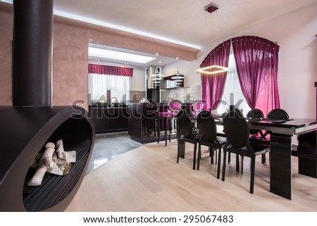 Close-up of stylish fireplace in living room - stock photo