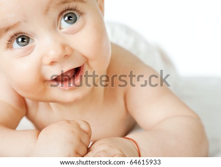 Close-up of sweet little baby face, smiling and looking up, copyspace - stock photo