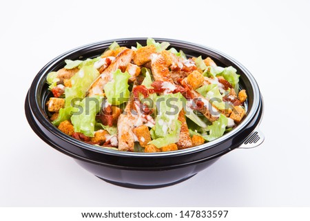 Close up of take away bowl with fast food salad with grilled chicken - stock photo