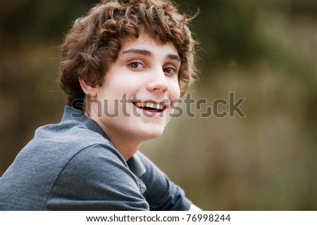close up of teen boy - stock photo