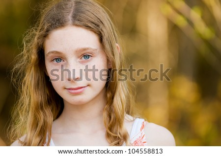 close up of teen girl with stunning blue eyes - stock photo