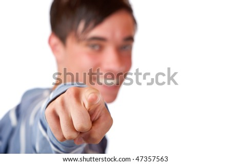 Close-up of teenager pointing with finger on camera. Isolated on white. - stock photo