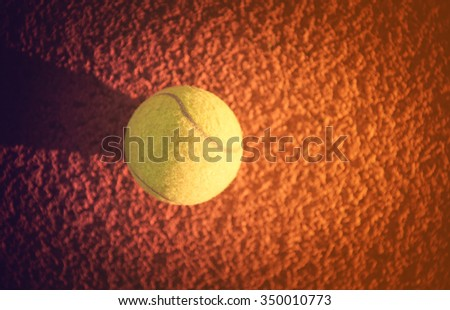 Close up of tennis ball on clay court./Tennis ball , vintage - stock photo