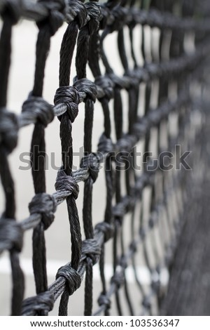 Close up of tennis fence mesh - stock photo