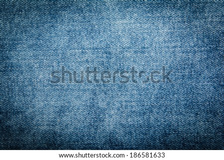 close up of Texture of blue jeans as background - stock photo