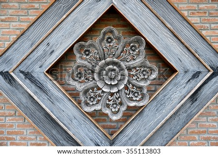 Close up of  Thai traditional flower wood carving - stock photo