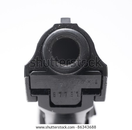 close-up of the barrel of a pistol - stock photo