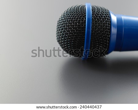 close up of the blue wired microphone - stock photo