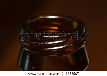 Close-up of the brown glass bottle necks. Narrow depth of field. - stock photo