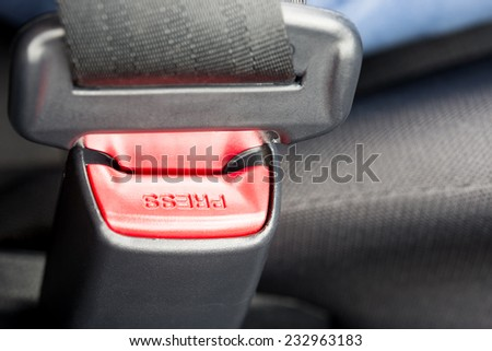 Close-up of the buckle of a seat belt or safety belt, vehicle safety device, concept of safe driving and transportation by car. - stock photo