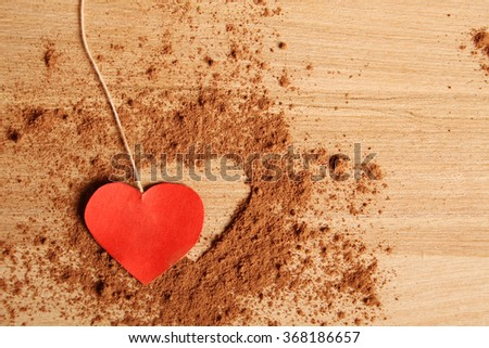 Close-up of the cocoa to make a form of heart - stock photo