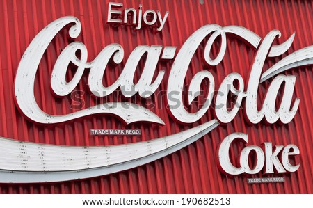 Close-up of the Coke Sign in Kings Cross, Sydney, AU, 1st April 2014. The Coca-Cola advertising red and white neon billboard at the intersection of William St. and Darlinghurst Road in Sydney. - stock photo