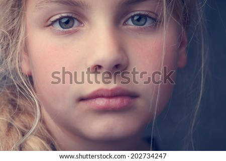 close up of the face from a young girl - stock photo