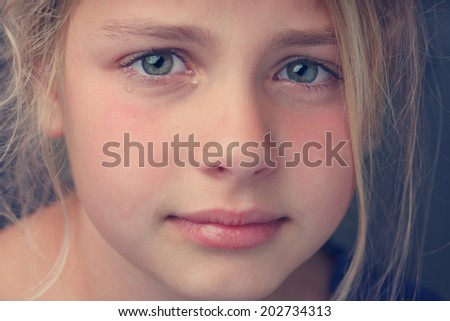 close up of the face from a young girl crying - stock photo