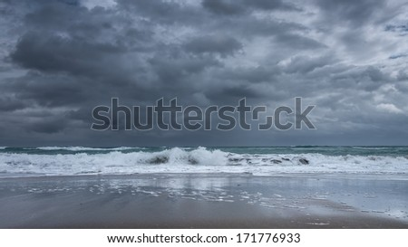 Close-up of the Florida shoreline right before a major downpour - stock photo