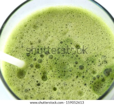 Close-up of the green vegetable juice in the glass - stock photo