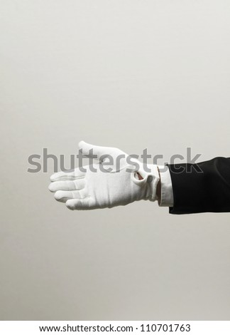 close up of the hand with white gloves - stock photo
