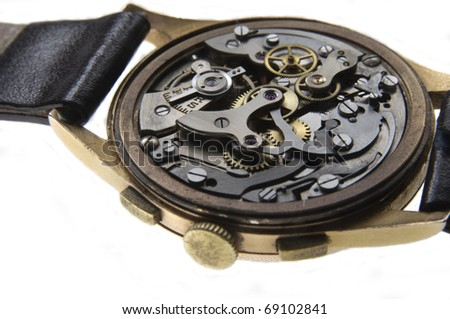 Close-up of the internal mechanism of an uncared-for antique clockwork, wind-up wristwatch. - stock photo
